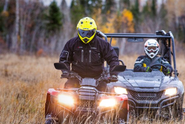 safe gear safe practices, atv riders with helmets in field