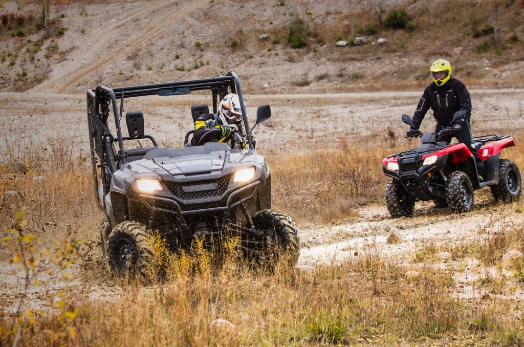 training and education, two atv'ers riding in a field